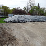 Excavated soil encapsulated prior to transporting to treatment facility
